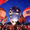 Crowds gather while hot air balloons from Shane Company and ReMax, along with others light up the night sky in the popular event held at Forest Park in St. Louis, MO on 9/19/14