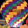 The Purina Farms hot air balloon lights up the night sky in the popular event held at Forest Park in St. Louis, MO on 9/19/14