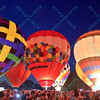 Amongst a large crowd hot air balloons light up the night sky in the popular event held at Forest Park in St. Louis, MO on 9/19/14