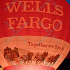 The Wells Fargo hot air balloon lights up the night sky in the popular event held at Forest Park in St. Louis, MO on 9/19/14