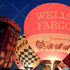 A brightly lit Wells Fargo hot air balloon lights up the night sky in the popular event held at Forest Park in St. Louis, MO on 9/19/14