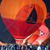 A large crowd watches hot air balloons light up the night sky in the popular event held at Forest Park in St. Louis, MO on 9/19/14