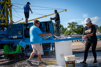 Thomas, Lisa, Sherwin, Julio, and Alberto, all from Tampa, scrub every beam of the Sky Flyer.