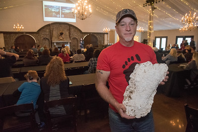 Paul Hulsey with one of his many cast of bigfoot foot prints.