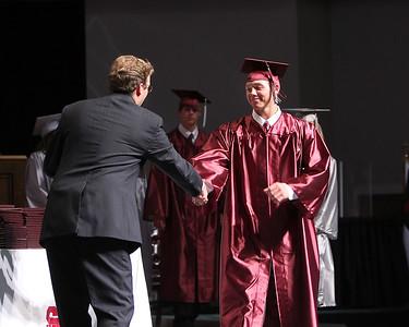 Devin Nichols shakes Mr. Crook's hand