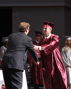 A proud Devin Nichols prepares to receive his diploma