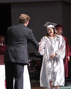 Ashley Payne prepares to shake Mr. Crook's hand