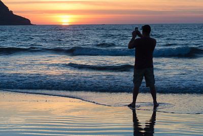 Tony trying to capture the sunset with his phone.