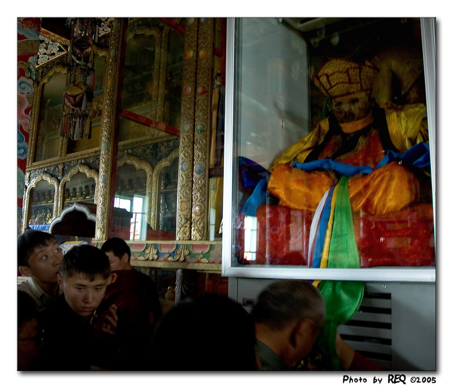 Believers and the curious, from as far away as Moscow, come to pay their respects to the 12th Khombo Lama by touching their foreheads to the khadaks (silk scarves) he wears. Please note - there is usually no photography allowed inside this and most other Buddhist temples. This photo was taken with the permission of the Itigilov institute.