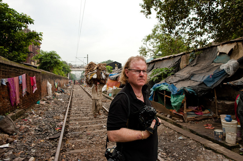 """People's shelters next to a """"live"""" railway track. In this area it's hard not to draw attention."""