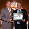 03-28-2010...2010 Ramapo High School Athletic Hall of Fame inductee,  Evan Baumgarten (right-Coach Boys Soccer) presented by Hall of Fame Committee Member Mike Miello.<br /> PHOTO: KELLY BIRDSEYE