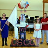 Debby High — For Montgomery Media<br /> Pennridge Central Middle School student Courtney Wood holds the flag as Gillian Wenhold and Jake Tygielski represent the U.S. Coast Guard.