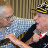 Debby High — For Montgomery Media<br /> Former state Rep. Paul Clymer listens as Harry Overbaugh Jr., 97, spoke of his service in the Army.