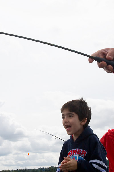 Snapshot gallery of the annual kids fishing event hosted by the Northshore Chapter of Trout Unlimited at Tracy Owens Station in Kenmore Washington on June 3rd, 2006. Images of children (and parents) fishing. All files are Copyright © 2006 J. Andrew Towell Please contact me at troutstreaming@gmail.com to negotiate for any and all usage rights.