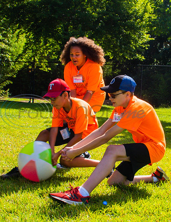 Campers Caleb Hernandez (left) Madison Head and Caleb Beaver dive for the ball in a game of elephant soccer during Zoo Camp Friday at Caldwell Zoo in Tyler.