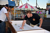 Community members enjoy the opening night of the Dublin's Firemen Carnival Wednesday, Aug. 13. Montgomery Media photo / DEBBY HIGH