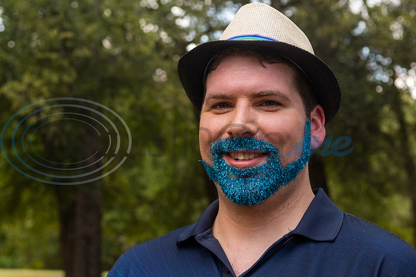 Kyle Graham, sporting a blue glitter beard, stands for a photo during Tyler Area Gay's inaugural Pride in the Park event Saturday, Sept. 21, 2019, at Southside Park in Tyler. (Cara Campbell/Tyler Morning Telegraph)