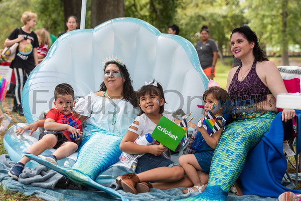Children sit for a photo with professional mermaids Lacy Young (second from left) and Saskia Lynge (right) during Tyler Area Gay's inaugural Pride in the Park event Saturday, Sept. 21, 2019, at Southside Park in Tyler. (Cara Campbell/Tyler Morning Telegraph)