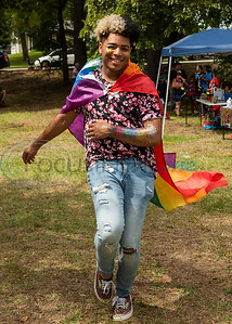 Paul Ballard, sporting colorful glitter on his face and arm, shows off his rainbow cape with a spin during Tyler Area Gay's inaugural Pride in the Park event Saturday, Sept. 21, 2019, at Southside Park in Tyler. (Cara Campbell/Tyler Morning Telegraph)