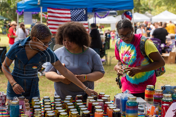 Attendees scope out items for sale at a vendor booth during Tyler Area Gay's inaugural Pride in the Park event Saturday, Sept. 21, 2019, at Southside Park in Tyler. (Cara Campbell/Tyler Morning Telegraph)