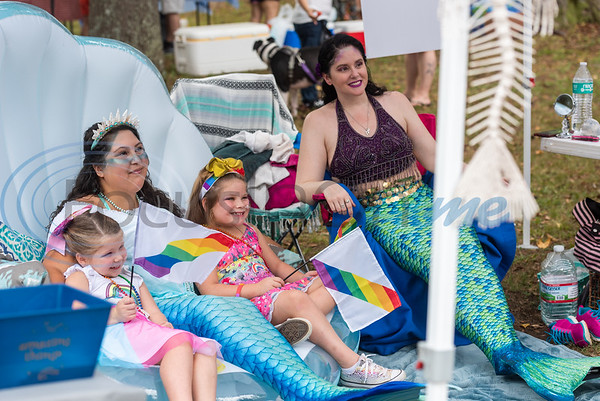 Sisters Avah Henson, 5, (left) and Aria Henson, 6, (second from right) sit for a photo with professional mermaids Lacy Young (second from left) and Saskia Lynge during Tyler Area Gay's inaugural Pride in the Park event Saturday, Sept. 21, 2019, at Southside Park in Tyler. (Cara Campbell/Tyler Morning Telegraph)