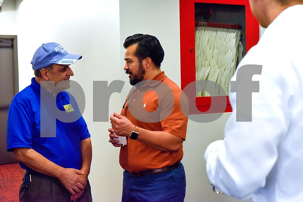 Dr. Manoucher R. Khosrowshahi and Nic Pesina chat during an open house event at the Tyler Morning Telegraph in Tyler, Texas, on Thursday, Oct. 12, 2017. (Chelsea Purgahn/Tyler Morning Telegraph)