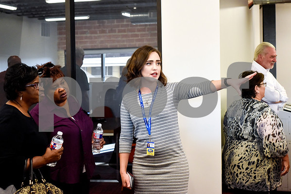 Raquelle Langlinais chats with people during an open house event at the Tyler Morning Telegraph in Tyler, Texas, on Thursday, Oct. 12, 2017. (Chelsea Purgahn/Tyler Morning Telegraph)