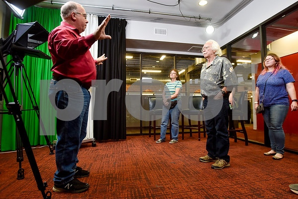 Richard Hall gives a tour of the video and photo studio during an open house event at the Tyler Morning Telegraph in Tyler, Texas, on Thursday, Oct. 12, 2017. (Chelsea Purgahn/Tyler Morning Telegraph)