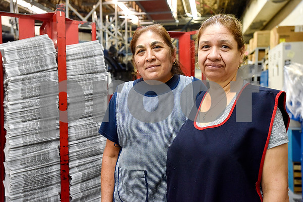 Tyler Morning Telegraph employees Aurelia Fernandez and Elva Gonzalez pose for a portrait during an open house event at the Tyler Morning Telegraph in Tyler, Texas, on Thursday, Oct. 12, 2017. (Chelsea Purgahn/Tyler Morning Telegraph)