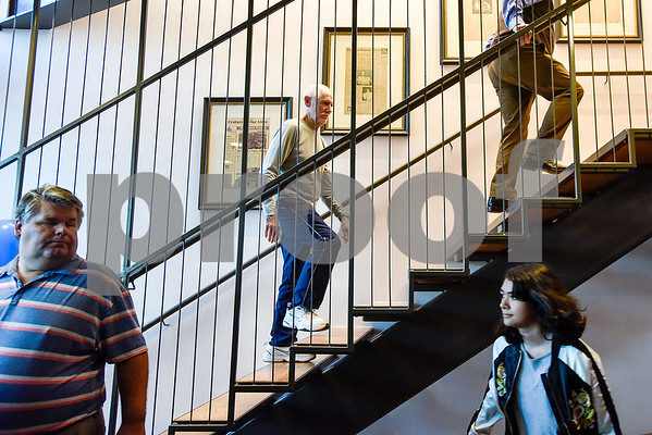 People walk in the entryway and up the staircase during an open house event at the Tyler Morning Telegraph in Tyler, Texas, on Thursday, Oct. 12, 2017. (Chelsea Purgahn/Tyler Morning Telegraph)