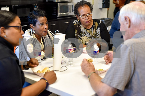 People eat dinner and chat during an open house event at the Tyler Morning Telegraph in Tyler, Texas, on Thursday, Oct. 12, 2017. (Chelsea Purgahn/Tyler Morning Telegraph)