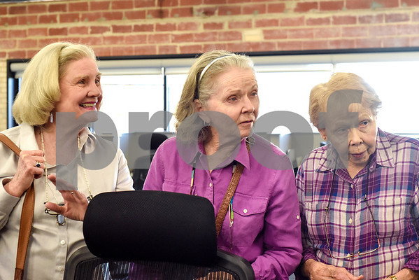 Carolyn Kuykendall, Ruth Stankewitz and Jo Wade listen to a Tyler Morning Telegraph employee speak during an open house event at the Tyler Morning Telegraph in Tyler, Texas, on Thursday, Oct. 12, 2017. (Chelsea Purgahn/Tyler Morning Telegraph)