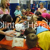 Kids bobbed for apples during Camanche Fall Festival on Saturday at Camanche Middle School. • Natalie Conrad/Clinton Herald