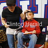 Face painter Kristal Shaff creates a work of art on Bentley Johnson's face at Camanche Fall Festival on Saturday at Camanche Middle School. • Natalie Conrad/Clinton Herald