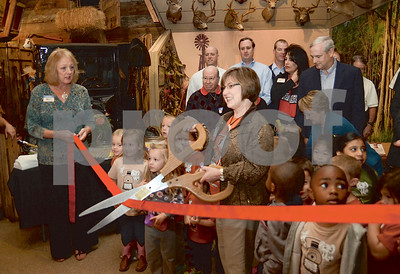 Photo by Noreen Nartia/ freelancer.  Tina Dixon cuts the ribbon at The Brookshires Museum for the new playground Wednesday, October 16.
