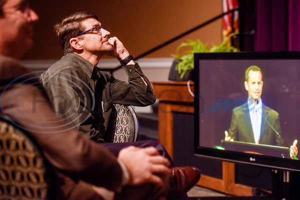 Jeff Hunter listens to actor Kirk Cameron speak during Christian Homes and Family Services' fall dinner at Green Acres Baptist Church in Tyler, Texas, on Tuesday, Oct. 16, 2018. (Chelsea Purgahn/Tyler Morning Telegraph)