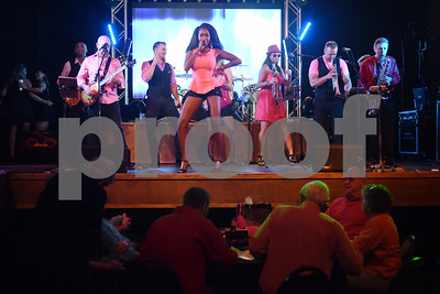 The Walton Stout Band performs at the Bras for a Cause charity event held at Coach's & Cowboy's bar in Tyler Tuesday Oct. 18, 2016. The event is sponsored by Tyler Women's Council of Realtors as part of National Breast Cancer Awareness Month. Proceeds benefit Susan G. Komen Foundation Tyler Firefighters Care Fund and local fire departments. Firefighters seek bids from the crowd for their themed bras and gift baskets.  (Sarah A. Miller/Tyler Morning Telegraph)