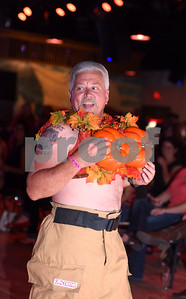 """Firefighter Tommy Brock of Winona models a bra themed """"Protect Your Pumpkins"""" at the Bras for a Cause charity event held at Coach's & Cowboy's bar in Tyler Tuesday Oct. 18, 2016. The event is sponsored by Tyler Women's Council of Realtors as part of National Breast Cancer Awareness Month. Proceeds benefit Susan G. Komen Foundation Tyler Firefighters Care Fund and local fire departments. Firefighters seek bids from the crowd for their themed bras and gift baskets.  (Sarah A. Miller/Tyler Morning Telegraph)"""