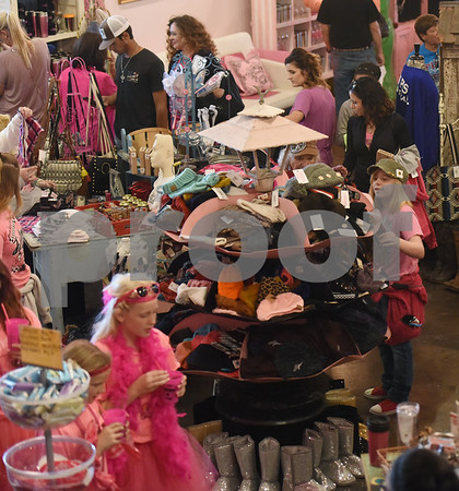 """Natalee Prda, 10, of Frankston, shops at The Pink Pistol during Pinktoberfest, hosted by The Cannery Lindale, The Pink Pistol, Love and War in Texas and the City of Lindale Oct. 22, 2016 in Lindale. The event, dubbed, a """"Texas Size Block Party"""" featured games, live music, a chili cook-off and MuttNation Foundation pet adoption. Pinktoberfest also served as the official grand opening of Love and War in Texas and The Pink Pistol.   (Sarah A. Miller/Tyler Morning Telegraph)"""