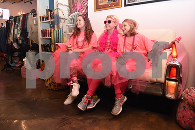 "Sydnee Spann, 13, of Ponder, Kalli Reed, 11, of Rosston and Madisen Deason, 10, of Rosston, take a photo at The Pink Pistol during Pinktoberfest, hosted by The Cannery Lindale, The Pink Pistol, Love and War in Texas and the City of Lindale Oct. 22, 2016 in Lindale. The event, dubbed, a ""Texas Size Block Party"" featured games, live music, a chili cook-off and MuttNation Foundation pet adoption. Pinktoberfest also served as the official grand opening of Love and War in Texas and The Pink Pistol.   (Sarah A. Miller/Tyler Morning Telegraph)"