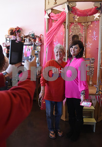 """Joan Houghton of Dallas has her photo taken with Beverly Lambert at The Pink Pistol during Pinktoberfest, hosted by The Cannery Lindale, The Pink Pistol, Love and War in Texas and the City of Lindale Oct. 22, 2016 in Lindale. The event, dubbed, a """"Texas Size Block Party"""" featured games, live music, a chili cook-off and MuttNation Foundation pet adoption. Pinktoberfest also served as the official grand opening of Love and War in Texas and The Pink Pistol.   (Sarah A. Miller/Tyler Morning Telegraph)"""