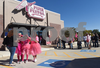 """People form a line waiting for the opening of Miranda Lambert's The Pink Pistol retail store during Pinktoberfest, hosted by The Cannery Lindale, The Pink Pistol, Love and War in Texas and the City of Lindale Oct. 22, 2016 in Lindale. The event, dubbed, a """"Texas Size Block Party"""" featured games, live music, a chili cook-off and MuttNation Foundation pet adoption. Pinktoberfest also served as the official grand opening of Love and War in Texas and The Pink Pistol.   (Sarah A. Miller/Tyler Morning Telegraph)"""