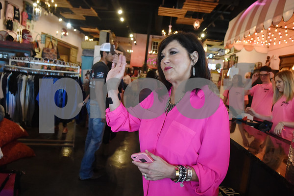 """Miranda Lambert's mother Beverly Lambert waves to customers entering The Pink Pistol during Pinktoberfest, hosted by The Cannery Lindale, The Pink Pistol, Love and War in Texas and the City of Lindale Oct. 22, 2016 in Lindale. The event, dubbed, a """"Texas Size Block Party"""" featured games, live music, a chili cook-off and MuttNation Foundation pet adoption. Pinktoberfest also served as the official grand opening of Love and War in Texas and The Pink Pistol.   (Sarah A. Miller/Tyler Morning Telegraph)"""