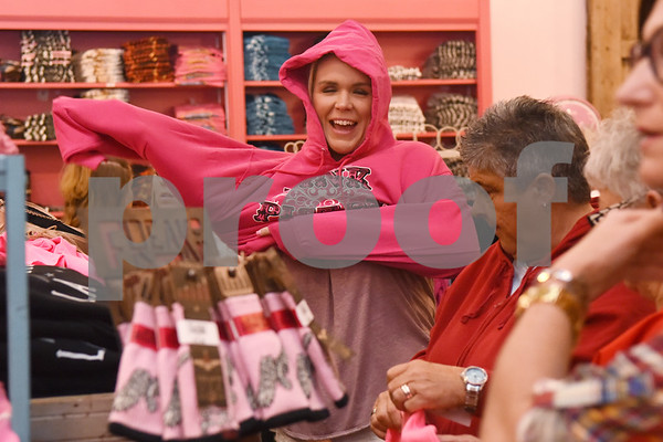 """Beth Chandler of San Antonio shops at The Pink Pistol during Pinktoberfest, hosted by The Cannery Lindale, The Pink Pistol, Love and War in Texas and the City of Lindale Oct. 22, 2016 in Lindale. """"I've always wanted to come here. I'm going to buy everything,"""" Chandler said. The event, dubbed, a """"Texas Size Block Party"""" featured games, live music, a chili cook-off and MuttNation Foundation pet adoption. Pinktoberfest also served as the official grand opening of Love and War in Texas and The Pink Pistol.   (Sarah A. Miller/Tyler Morning Telegraph)"""