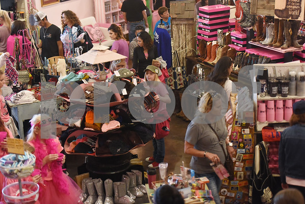 """Large crowds shop at The Pink Pistol during Pinktoberfest, hosted by The Cannery Lindale, The Pink Pistol, Love and War in Texas and the City of Lindale Oct. 22, 2016 in Lindale. The event, dubbed, a """"Texas Size Block Party"""" featured games, live music, a chili cook-off and MuttNation Foundation pet adoption. Pinktoberfest also served as the official grand opening of Love and War in Texas and The Pink Pistol.   (Sarah A. Miller/Tyler Morning Telegraph)"""