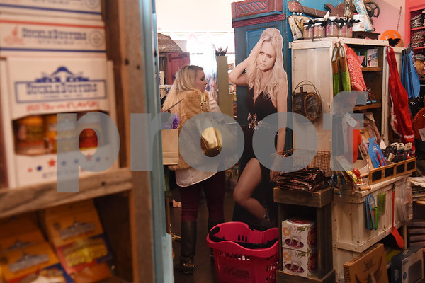 """A life-size cutout of Miranda Lambert greets customers at The Pink Pistol during Pinktoberfest, hosted by The Cannery Lindale, The Pink Pistol, Love and War in Texas and the City of Lindale Oct. 22, 2016 in Lindale. The event, dubbed, a """"Texas Size Block Party"""" featured games, live music, a chili cook-off and MuttNation Foundation pet adoption. Pinktoberfest also served as the official grand opening of Love and War in Texas and The Pink Pistol.   (Sarah A. Miller/Tyler Morning Telegraph)"""