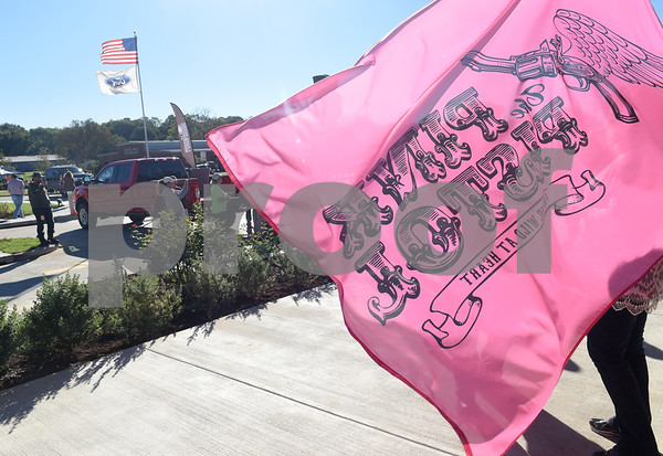 "A flag flies in the wind outside of Miranda Lambert's The Pink Pistol store during Pinktoberfest, hosted by The Cannery Lindale, The Pink Pistol, Love and War in Texas and the City of Lindale Oct. 22, 2016 in Lindale. The event, dubbed, a ""Texas Size Block Party"" featured games, live music, a chili cook-off and MuttNation Foundation pet adoption. Pinktoberfest also served as the official grand opening of Love and War in Texas and The Pink Pistol.   (Sarah A. Miller/Tyler Morning Telegraph)"