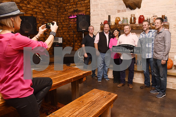 """The Cannery developers Bill Andreason and Chad Michael, Miranda Lambert's parents Beverly and Rick Lambert, Love and War owner Ty Phelps and The Cannery developer Chad Franke pose for a photo at The Pink Pistol during Pinktoberfest, hosted by The Cannery Lindale, The Pink Pistol, Love and War in Texas and the City of Lindale Oct. 22, 2016 in Lindale. The event, dubbed, a """"Texas Size Block Party"""" featured games, live music, a chili cook-off and MuttNation Foundation pet adoption. Pinktoberfest also served as the official grand opening of Love and War in Texas and The Pink Pistol.   (Sarah A. Miller/Tyler Morning Telegraph)"""