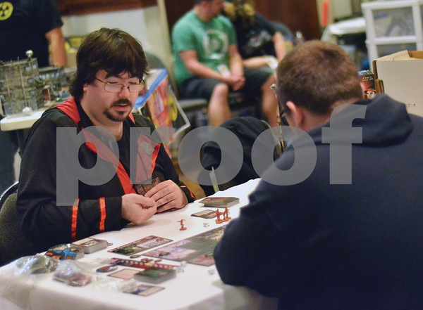 John Reynolds, of Arp, (left) and Patrick Martin, of Tyler, play The Last Night on Earth, a zombie survival role-playing board game in front of the Ground Zero Comics display. (Victor Texcucano)