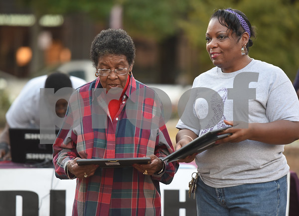 Celeste Craig of Tyler ISD, left, receives an award from Angela Gray during the East Texas Crisis Center Domestic Violence Awareness Month Hope Awards held Wednesday night at T.B. Butler Fountain Square.  (Sarah A. Miller/Tyler Morning Telegraph)